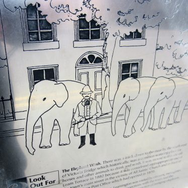 Plaque about the Elephant Wash with picture of Sam Lockhart & a string of elephants passing a Georgian style house   Anne Langley