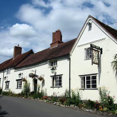 White painted pub made up of a row of three cottages | Image courtesy of Anne Langley