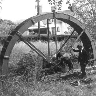 Arrow.  Waterwheel