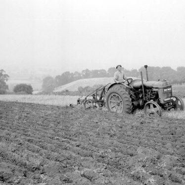 Burton Dassett.  Farmworker ploughing the hills