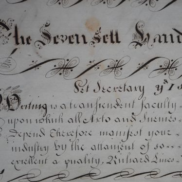 'The Seven Sett Hands' - an example of penmanship that reads 'writing is a transcendent faculty', surrounded by flourishes. | Warwickshire County Record Office reference CR2539