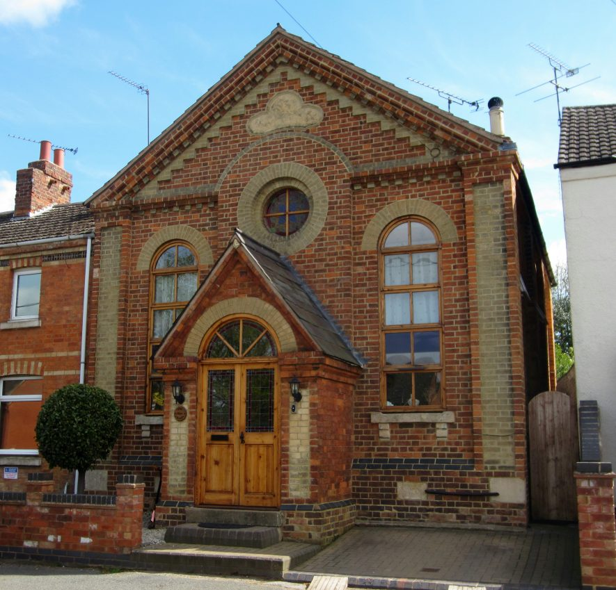 Long Lawford former Primitive Methodist Chapel. Red brick building with yellow brick dressings, arched windows and doorway; roundel above the porch; denticulated brickwork at eaves | Image courtesy of Anne Langley