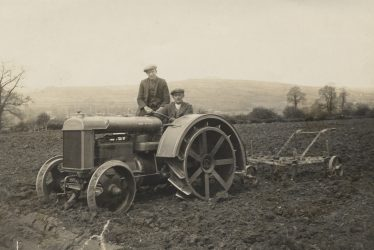 Long Compton. A Tractor and Plough in a Field at Yerdley Farm