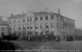 The Humber Motor Works, Far Gosford Street, after the fire of December 24th 1906. A crowd looks on as a charred building smoulders.   Express Photo Co., Rugby. Warwickshire County Record Office reference PH350/729