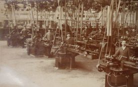 The Machine Shop (Grinders) at the Humber Works, presumably at the then new Stoke plant. 1900s. A bunch of men freeze for the camera surrounded by their machinery.   Warwickshire County Record Office reference PH352/65/61