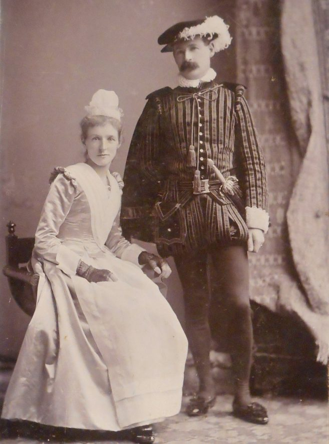 Photograph of man and woman in fancy dress, New Year's Eve 1897 at Kenilworth Gate House.   Photograph by R. L. Graham, Leamington. Warwickshire County Record Office reference PH461/44