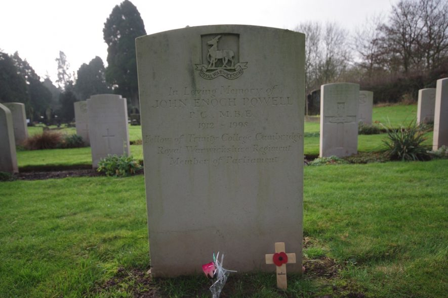 Enoch Powell's grave. A flower and cross with poppy are laid against it. | Photo by Derek Donaldson