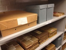 Photo negatives and log books on shelves.   Photo by Gary Collins.