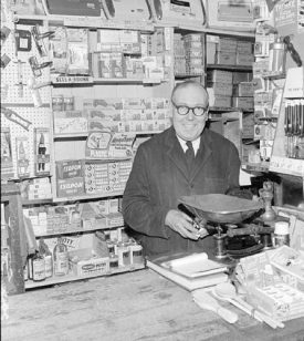 Mr Ronnie Collett in his ironmonger's shop in Queens Road, Nuneaton. August 30th 1968. | Warwickshire County Record Office reference PH(N)882/3094