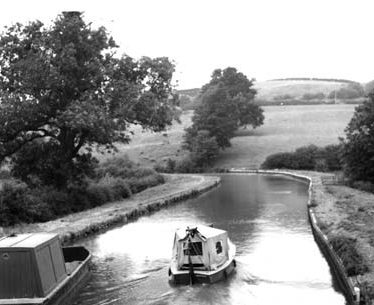 The Oxford Canal, near Napton on the Hill; with small canal cruiser and small maintenance boat. 1960s. |  Reference PH599-462.