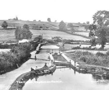 The Oxford Canal and locks looking north at Napton on the Hill. Three children are on the towpath, 1910s. | Reference PH352/128/15