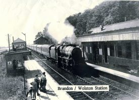 Brandon and Wolston Station (1940s?). Steam train, signal box, travellers on platform | HJ Stretton-Ward