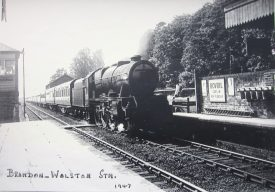 Brandon and Wolston Station, 1947. Steam train, signal box and Bovril advert | HJ Stretton-Ward