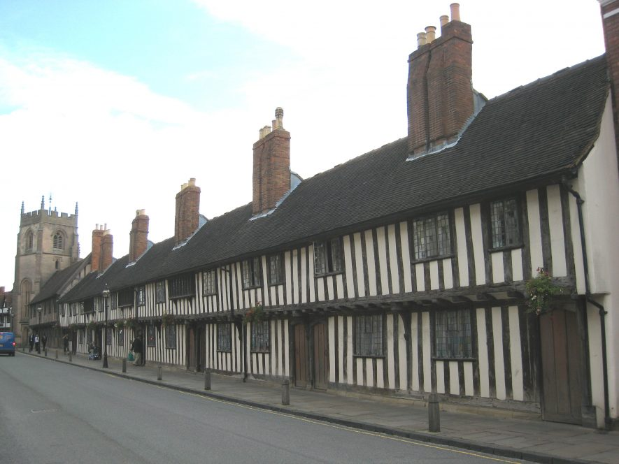 Church Street Almshouse, Grammar School & Guild Chapel, Stratford upon Avon. Timber-framed row of buildings, with a jetted upper storey | Image courtesy of Anne Langley