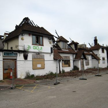 Former pub vandalised, ruined by fire and cordoned off, a few blackened rafters reaching for the sky | Anne Langley