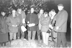 Group in the dark standing round the base of Knightlow Cross: Duke's agent speaking. Tree leaves behind | Image supplied by Roger Clemons