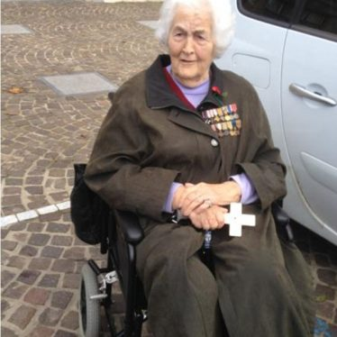 June wearing Dorothie's medals as well as those of her father Charles Moore. | Picture (c) Johanna Moore