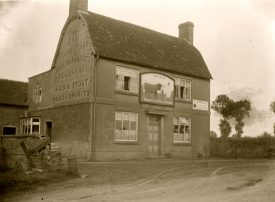 The Old Bull and Butcher pub at Ryton on Dunsmore. On side of pub name plus advert for Phillips & Marriott Coventry Ales & Stout Wines and Spirits. On front, large pub sign with picture of bull. | Warwickshire County Record office reference PH827/2/26. Reproduced with the permission of the Local Studies Collection at Rugby Library.