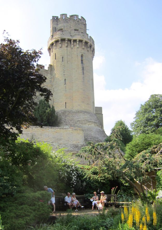 Warwick Castle from Mill Street gardens: tower, walls and people sitting in the garden | Anne Langley