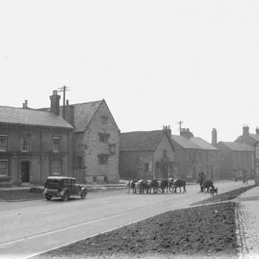 The Old Mint, Coventry Street. Motor car and cattle in road. January 1938. | Warwickshire County Record Office reference PH(N) 600/134/4