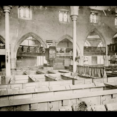 The photograph shows the interior with box pews and a pulpit and wide galleries around the church. | Warwickshire County Record Office ref. PH 827/4/23. Reproduced with the permission of Warwickshire County Council from the Local Studies Collection at Rugby Library.