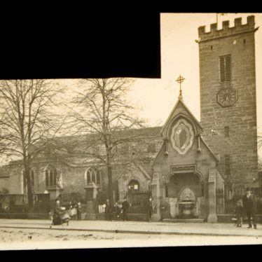 The photograph shows the exterior from Church Street with an elaborate porch and a square tower. There are figures and bare trees in the foreground | Warwickshire County Record Office ref.PH 827/4/24. Photographer E.H. Speight. Reproduced with the permission of Warwickshire County Council from the Local Studies Collection at Rugby Library.