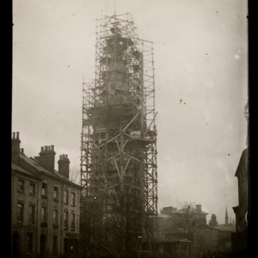 The photo shows the church spire under construction surrounded by scaffolding | Warwickshire County Record Office ref. PH 827/4/25. Reproduced with the permission of Warwickshire County Council from the Local Studies Collection at Rugby Library.