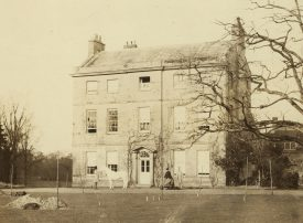 Photograph of the east front of Woodcote House, Leek Wootton. The photograph dates from 1860 and must have been taken shortly before the house was demolished and rebuilt by Henry Christopher Wise. The posts visible in the foreground of the shot may relate to the new build. | Warwickshire County Record Office reference CR 26/5/5/1