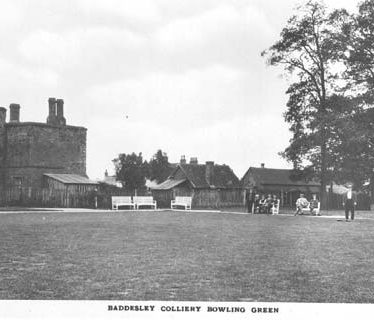 Baddesley Colliery Bowling Green with building , pavilion and men seated on benches. 1920s | Warwickshire County Record Office reference PH 352/18/1.