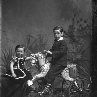 One of Robert Graham's portraits. A young boy is on a rocking horse with another child facing. | Warwickshire County Record Office reference CR 2555/4931