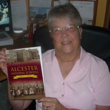 Karyl Rees with her book 'Alcester's National Schools', 2013 | Picture supplied by Joy Pegrum
