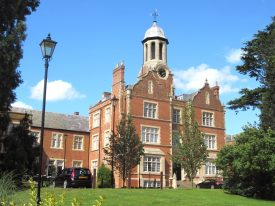 Tredington Park (foHandsome red brick building with stone dressings; 2-storey wings and a 3-storey entrance with cupola clock-tower above | Image courtesy of Anne Langley