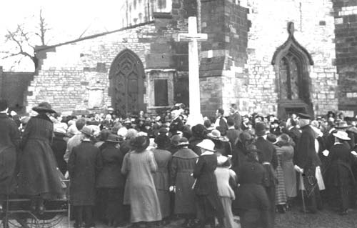 Southam. Armistice Day Service. View of the crowd by the war memorial outside the Church. 1920s | Warwickshire County Record Office reference PH 350/2050