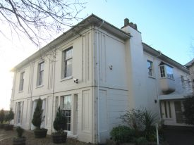 White stucco building in Georgian style   Anne Langley