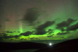 Aurora borealis over Muckle Flugga. From Saxa Vord - the bright light is the Muckle Flugga lighthouse. | Photograph copyright Mike Pennington. Originally uploaded to  https://www.geograph.org.uk/ and licensed under the Creative Commons ShareAlike 2.0 license.