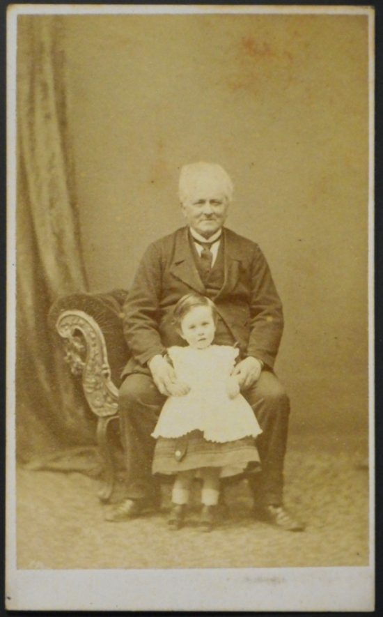 Charles Healy with grandson Henry William Worth Townsend, c.1873-1874 Photograph by Mrs E. Higgins, Photographer, Stamford. | Warwickshire County Record Office, CR4651/446