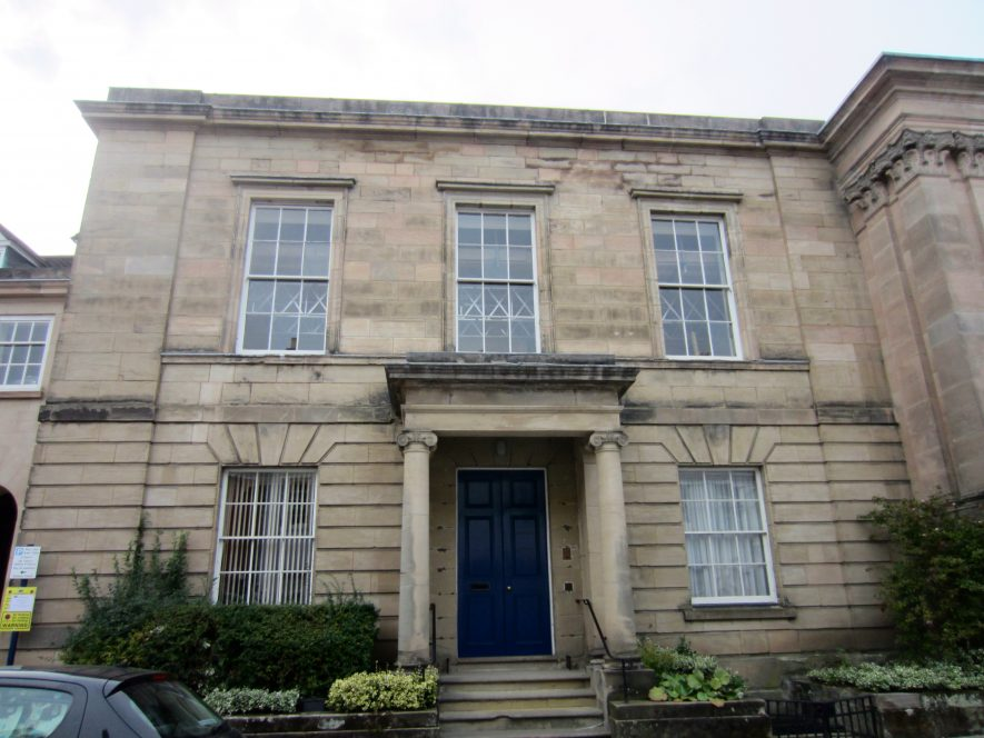 A 2-storey stone building with rustication below and Ionic columns supporting a porch over the front door | Anne Langley