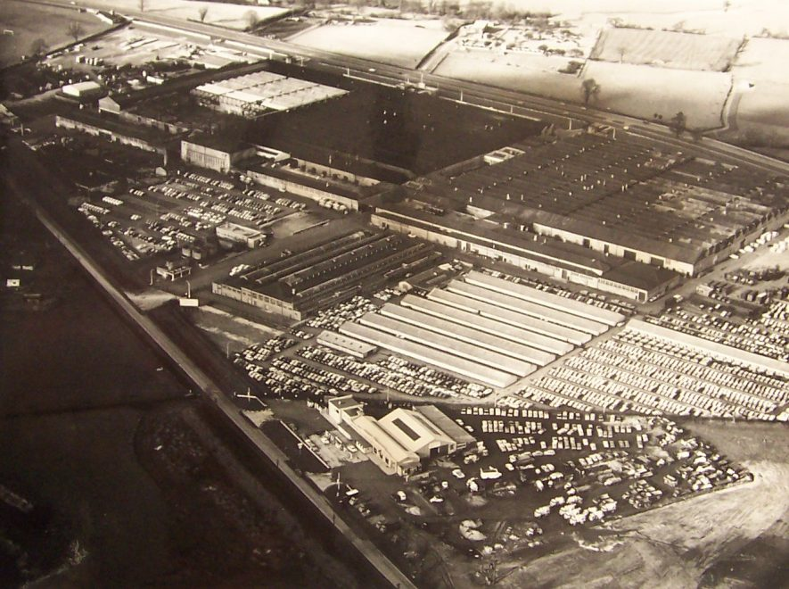 The Rootes factory at Ryton, 1960s. An aerial photograph showing a number of cars parked to the bottom right. | Photo by John P. Webster, Avionics Engineer. Warwickshire County Record Office reference PH970/57