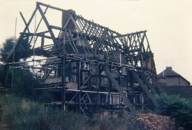 The house looking rather forlorn, in the 1970s. Only the timber frames survive, and the building is propped up by scaffolding.   Warwickshire County Record Office reference PHT 626/13