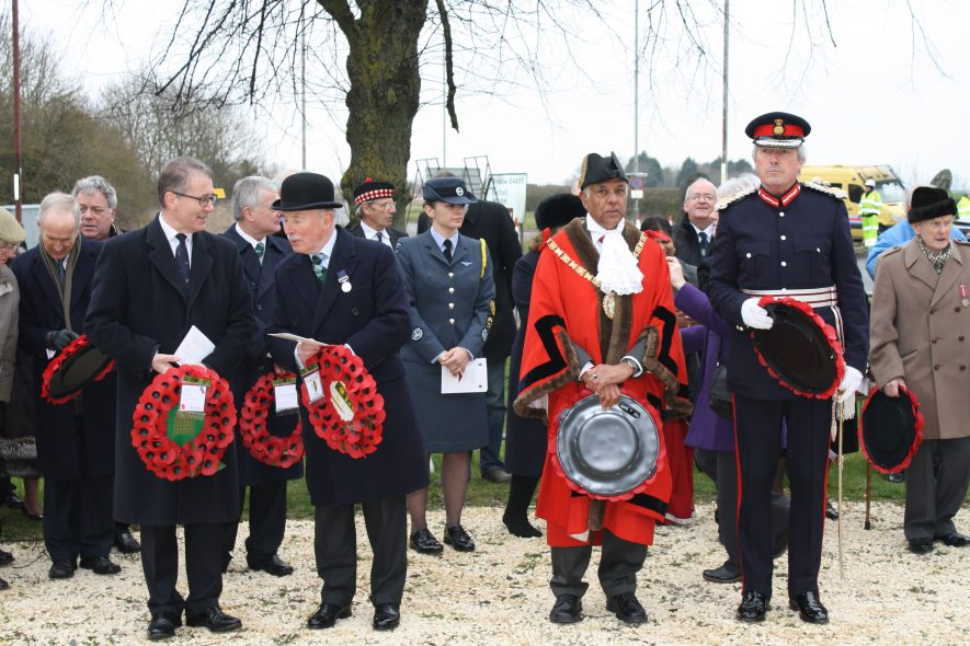 The Mayor of Rugby (in red robe and chain of office), an officer in uniform and members of the Gallipoli Association holding poppy wreath | Roger Clemons
