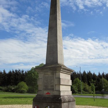 Stone obelisk on roundabout with poppy wreaths at the base | Anne Langley