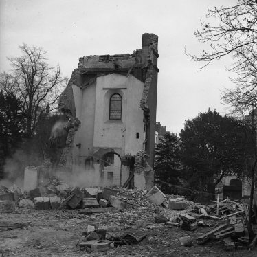 Christ Church being demolished. A solitary wall still stands. | Warwickshire County Record Office reference PH(N) 600/432/1