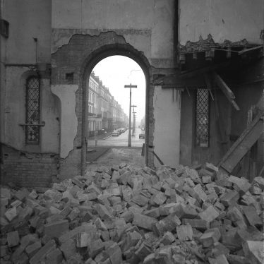 Christ Church being demolished. Rubble fills the floor, looking towards a doorway. | Warwickshire County Record Office reference PH(N) 600/432/2