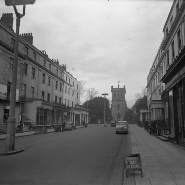 Looking up the parade to Christ Church. A Morris Minor is parked on the left, an Austin A40 Somerset on the right. A 'No Parking' sign is immediately in front of the camera. | Warwickshire County Record Office reference PH(N) 600/662/10