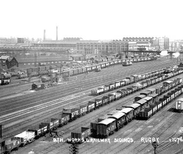Large factory site with buildings, chimneys etc. Numerous railway lines in foreground with wagons on | Photographer Victor W. Long. Warwickshire County Record Office PH 350/1883