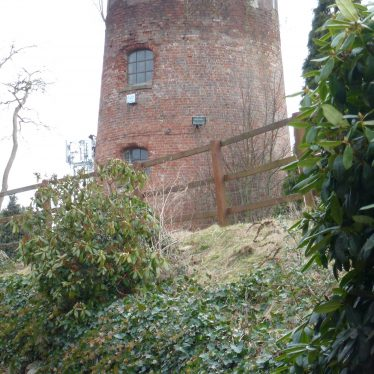 Run down windmill; red brick tower with no sails, built in 1821. As seen in 2015 | Ron Thorpe