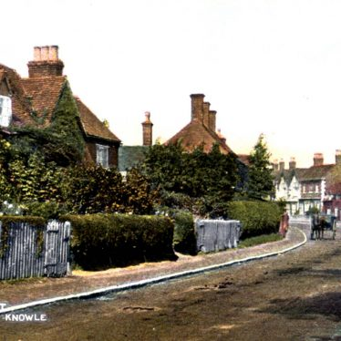Colour post card of house covered in creeper with picket fence. Other houses in the background with a horse and cart | Knowle Local History Society image library