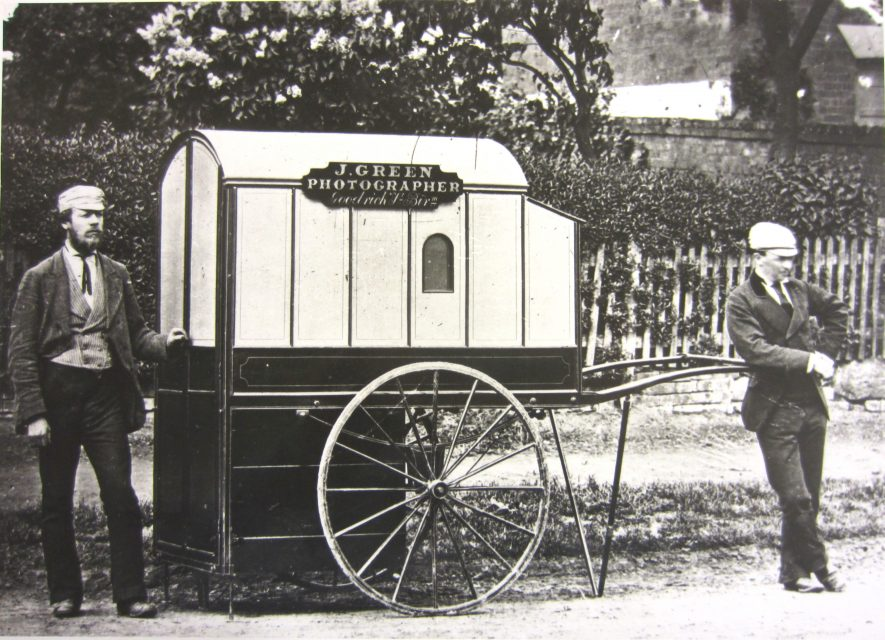 Handcart with covered top and two men standing by it   Warwickshire County Record Office reference PH 66/17