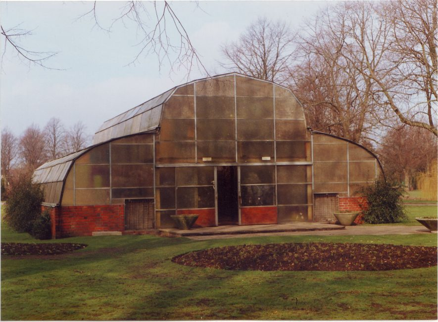 Large greenhouse with tall central part and lower aisles each side in park with bare trees | Nuneaton Memories