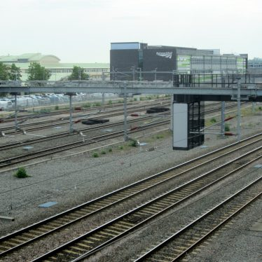 Railway lines & gantry with car park, Network Rail and Warwickshire College buildings behind | Anne Langley